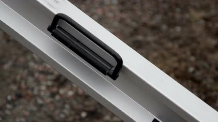 clipping path : A steel beam used for construction. Black hinges in the equipment are found and a silver metal attached to it that looks like a ladder.
