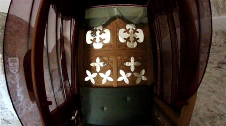 brocade : Palanquin with maroon cloth to cover the sides. The palanquin back has a wood carving that looks like a four leaf clover. Stock Footage