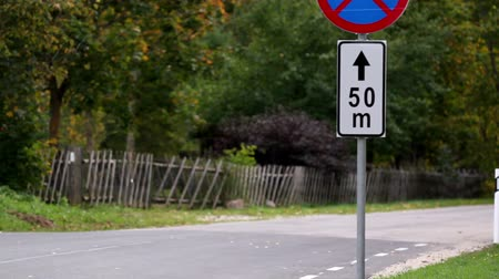 clipping path : Road sign found at the side of the road so drivers can easily see the road sign and follow it.