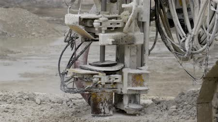 mayın : A rock driller machine in a mining industry