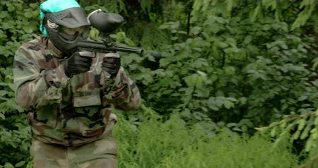paintball : A man with camouflage outfit is playing a paintball 4K FS700 Odyssey 7Q