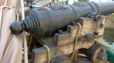 pirat : A small cannon handicraft on the boat on dock. Well crafted small souvenier for the traveller