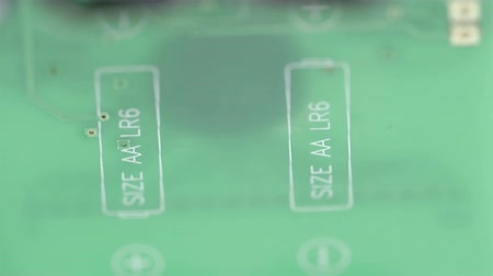 kgb : The green micro chip of the battery showing the + - sign of the battery Stock Footage