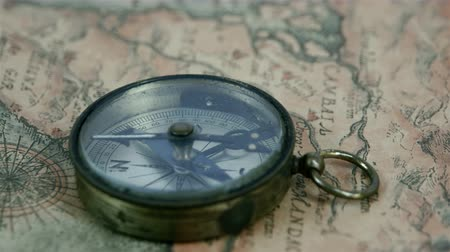 pusula : The second arrow of the compass is moving around. The compass is on top of the navigational map