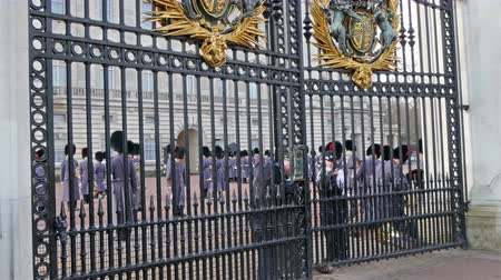 buckingham palace : The opening of the big gate in Buckingham Palace. Guards are about to open the gate.  in 4K UHD