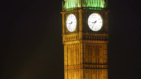 башни : Zooming out of the Big Ben at night. The time is 8:35 in the evening at London in 4K UHD