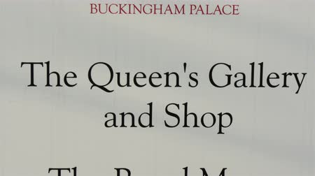 buckingham palace : Buckingham Palaces The Queens Gallery and Shop and The Royal Mews and shop. Its a sign found inside the Buckingham Palace in 4K UHD