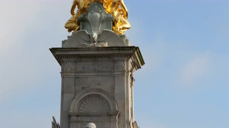 buckingham palace : The white monument with gold angels structure on top. It is located infront of the Buckingham Palace in 4K UHD