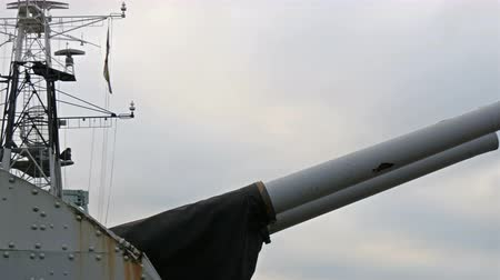 belfast : Two huge artillery cannons on top of the warship. They are on the roof of the ship of the Belfast Stock Footage