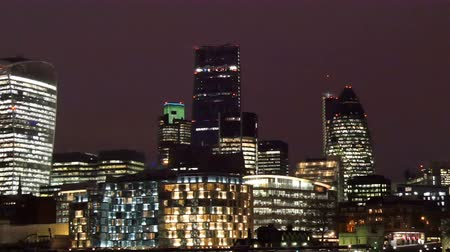 bina : The city of London on a night view. Where lights of the buildings makes the city brighter