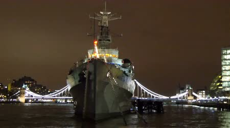 belfast : Crossing along the Belfast warship in Thames river. Seen is the docking warship and the beauty of the city at night