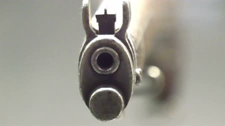 av : Closer look of the front of a shot gun and the hole infront where the bullets gets out