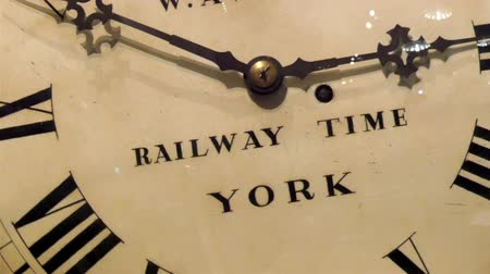 minute hand : The huge railway time clock in London. It is in white color with black hour and minutes hand