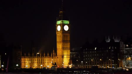 big ben : The yellow lights that focuses the Big Ben at night Stock Footage