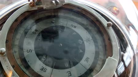 pusula : A big compass in the crews deck on a warship names Belfast Stok Video