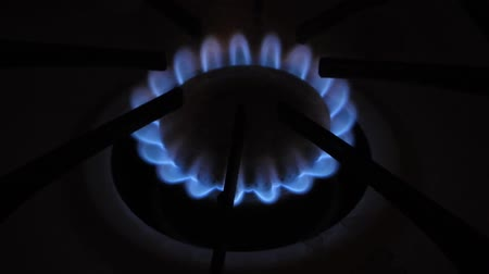 A blue flame emits from a gas cooker. 動画素材