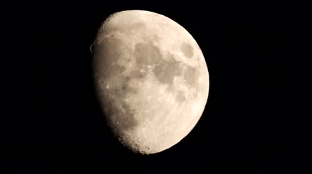 lunar surface : The Moon is a beautiful sight for everyone all around the world. Here we see it close up, bright above our night sky. Stock Footage