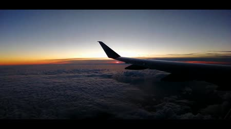 A view from up in the stratosphere, the sun setting in the background.