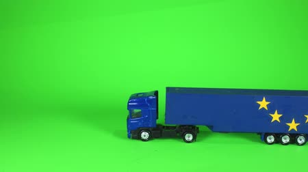 A typical articulated lorry shown in the colour dark blue with the word Brexit on the side. Goods looking to be just one of the issues of Brexit.