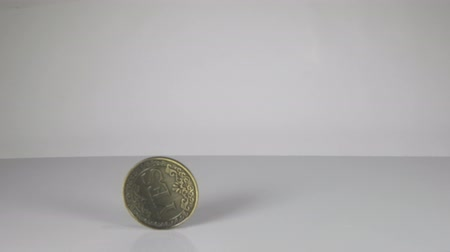 A large coin in a hand that has just been flipped shows the word No. 動画素材