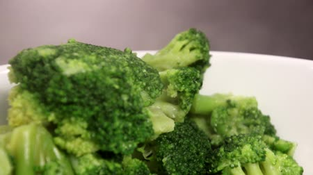hard boiled : Delicious and healthy steam cooked broccoli steaming after a long cook.