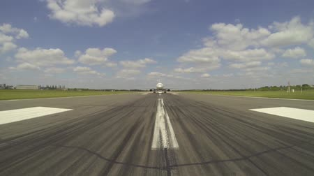 burger : A vehicle drives in front of a large aircraft to give it guidance on where to go and where to park.