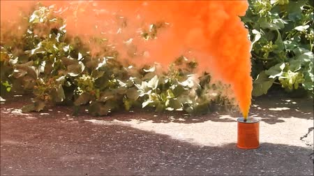 grenade : A very bright orange smoke grenade which is used to indicate a position for emergency or to locate. Stock Footage