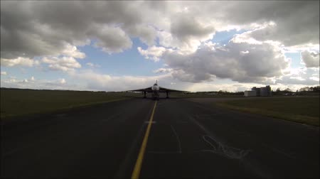 bomber : A vehicle drives in front of a large aircraft to give it guidance on where to go and where to park.