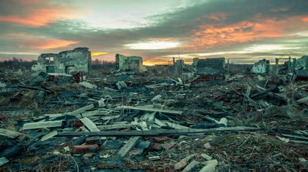 judgment day : Apocalyptic landscape.The remains of destroyed houses at sunset. Stock Footage