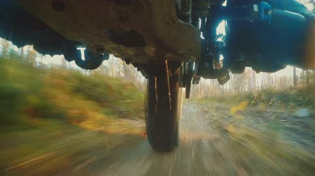 lovas : Extreme camera.Enduro motorcycle riding in the mud. Shooting from below