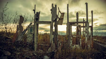 judgment day : Apocalyptic landscape.The remains of destroyed houses at sunset Stock Footage
