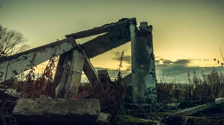 judgment day : Apocalyptic landscape. The concrete beams of a ruined house at sunset