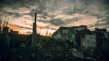 judgment day : The post-apocalyptic world.Dramatic dawn sky over the walls of a ruined house