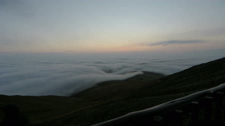 над : Time lapse of a sunrise over clouds in the Drakensberg mountains.