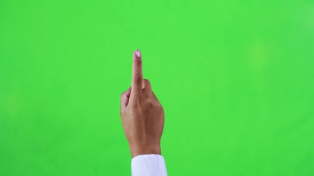fare : A female in a shirt making touch screen gestures in green screen Stok Video