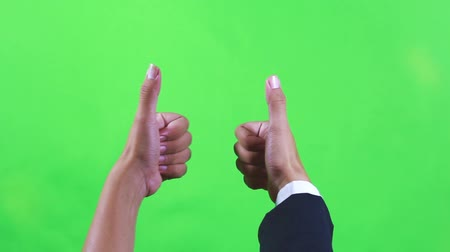 polegar : Group of hands make sign of OK or Good in green screen