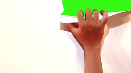 бумага : attractive hand gesture opening paper into green screen Стоковые видеозаписи