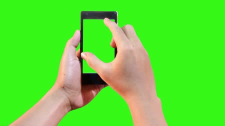 dokunaklı : attractive hand gesture touching virtual smart phone on green screen Stok Video