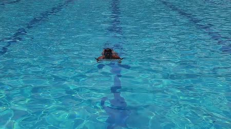 man swimming in a swimming pool Stock Footage