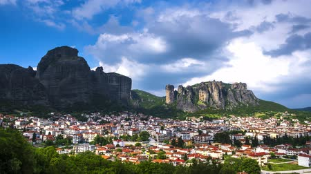 kalambaka : View of Meteora rocks and Kalambaka and Kastraki village at daytime in sunshine and great clouds fly over - timelapse