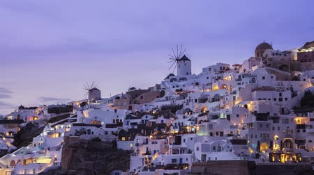 УВР : View of sunset at Oia village on island of Santorini, Greece -  timelapse