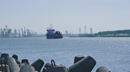 gaivota : Suction dredger ship entering industrial port on sunny day - view from behind
