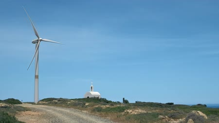 회 전자 : Single wind turbine and orthodox Greek church in hill landscape on sunny clear day