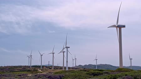 회 전자 : Diagonal shot of wind turbine farm in hill landscape on clear sunny day 무비클립
