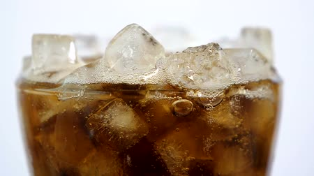 cola : Slow motion  High Speed Video of Cola soft drink with ice in the glass