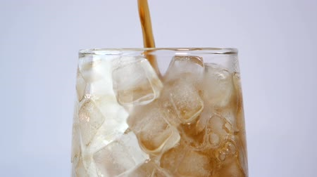 cola : Pouring of Cola soft drink with ice in the glass