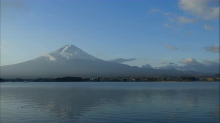 fuji : Timelapse of Fuji Mountain view with lake under blue sky in the morning. Stock Footage