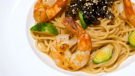 spagetti : Motion video of seafood pasta  Spaghetti with shrimp on white dish (Selective Focus)