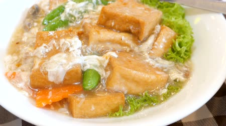 soya peyniri : Motion video of Braised tofu with crab on dish in the restaurant (Chinese food) Stok Video
