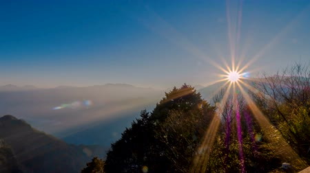 montar : Timelapse landscape sunrise over mountain with flare in the morning at Zhushan station, Alishan National Park, Taiwan. (4K Video)